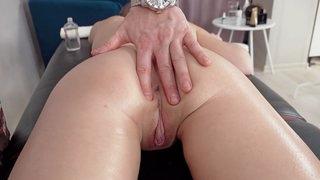 Massagist cums all over naked cutie